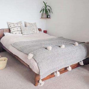 grey woven pompom blanket