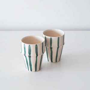 white ceramic cup teal stripes