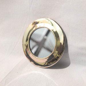 round brass mirror